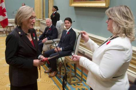 Governor General David Johnston and Prime Minister Justin Trudeau look on as Carolyn Bennett is sworn in as the Minister of Indigenous and Northern Affairs during ceremonies at Rideau Hall, Wednesday Nov.4, 2015 in Ottawa. THE CANADIAN PRESS/Adrian Wyld